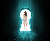Businesswoman standing in keyhole door