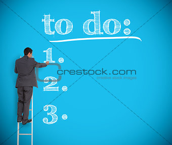 Businessman writing a to do list on a giant wall