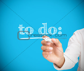 Businessman writing to do with a chalk