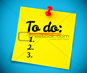 Yellow post it with a to do list written on it