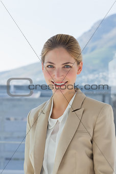 Portrait of a smiling businesswoman in a modern office