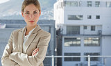 Businesswoman with arms folded in her office
