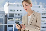 Businesswoman touching her smartphone
