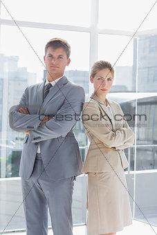 Business colleagues standing in their modern office