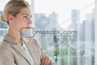 Serious businesswoman standing with arms crossed