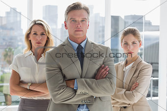 Three business people standing together