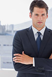 Handsome businessman standing with arms crossed