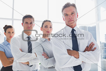 Business people standing together in line