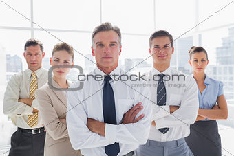 Business people with arms crossed in their office