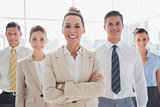 Group of smiling business team standing together