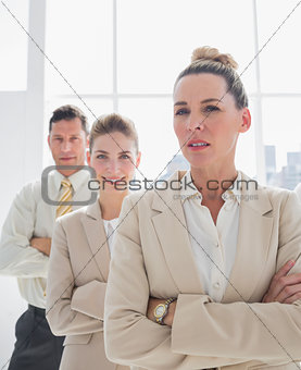 Attractive businesswoman standing with arms crossed