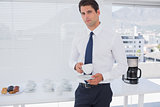 Businessman having a coffee during the break