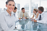 Smiling brunette businesswoman in a meeting