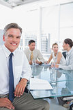 Smiling businessman during a meeting