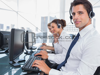 Portrait of smiling call center employee