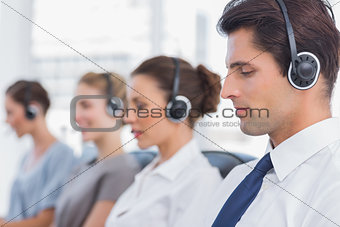Group of agents sitting in line in a call centre