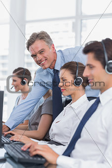 Call centre working with headset