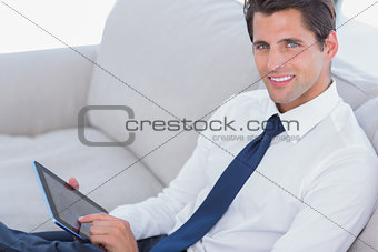 Smiling businessman using digital tablet