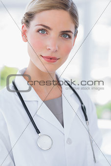 Blond woman doctor standing