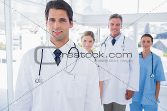 Attractive doctor in front of his team