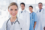 Woman doctor in front of her colleagues