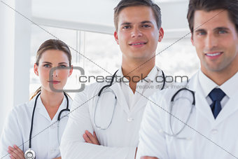 Three smiling doctors with lab coats