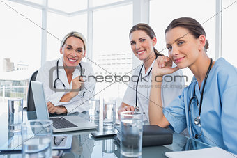 Three smiling women doctors