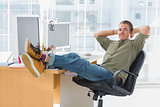 Designer relaxing with foot on the desk