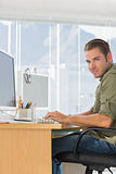 Cheerful creative business employee working on computer