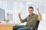 Creative business employee raising arms