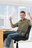 Cheerful creative business employee raising arms