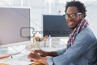 Portrait on a creative business worker on computer