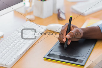 Close up of a graphic designer using graphics tablet