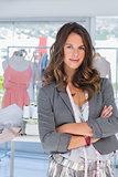 Fashion designer with measuring tape around her neck
