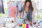 Fashion designer measuring a mannequin