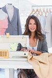 Fashion designer sewing textile
