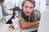 Fashion designer with his chihuahua