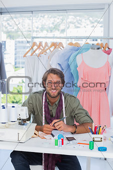 Attractive fashion designer smiling