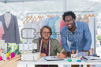 Attractive fashion designers working together
