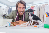 Fashion designer looking at camera with his chihuahua