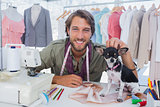 Fashion designer petting his chihuahua