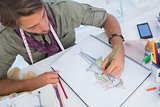 Fashion designer creating a coat for woman