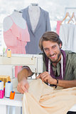 Fashion designer sewing