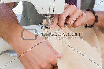 Close up of man sewing