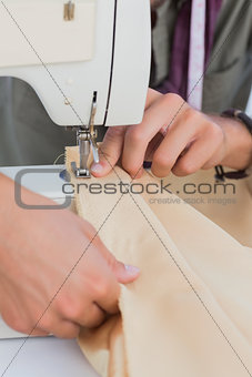 Close up of hands of a fashion designer