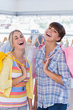 Cheerful women with shopping bags