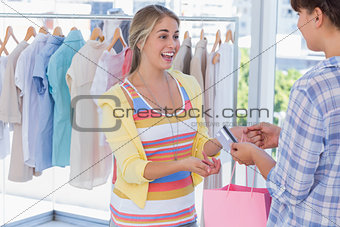 Cashier giving credit card to customer