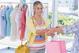 Attractive customer receiving her credit card