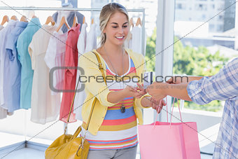 Attractive customer receiving her credit card