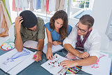 Three fashion designers working together